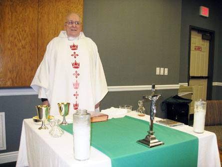 Rev. John A. Leies presides at Thursday night Mass in Founders Hall